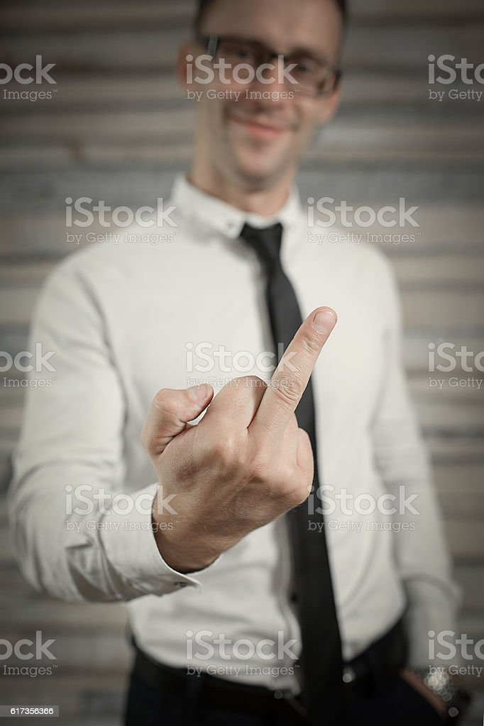 Businessman manager show middle finger or Fuck You sign isolated stock photo