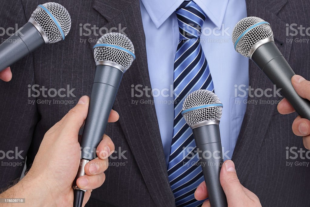 Businessman media contact being interviewed stock photo
