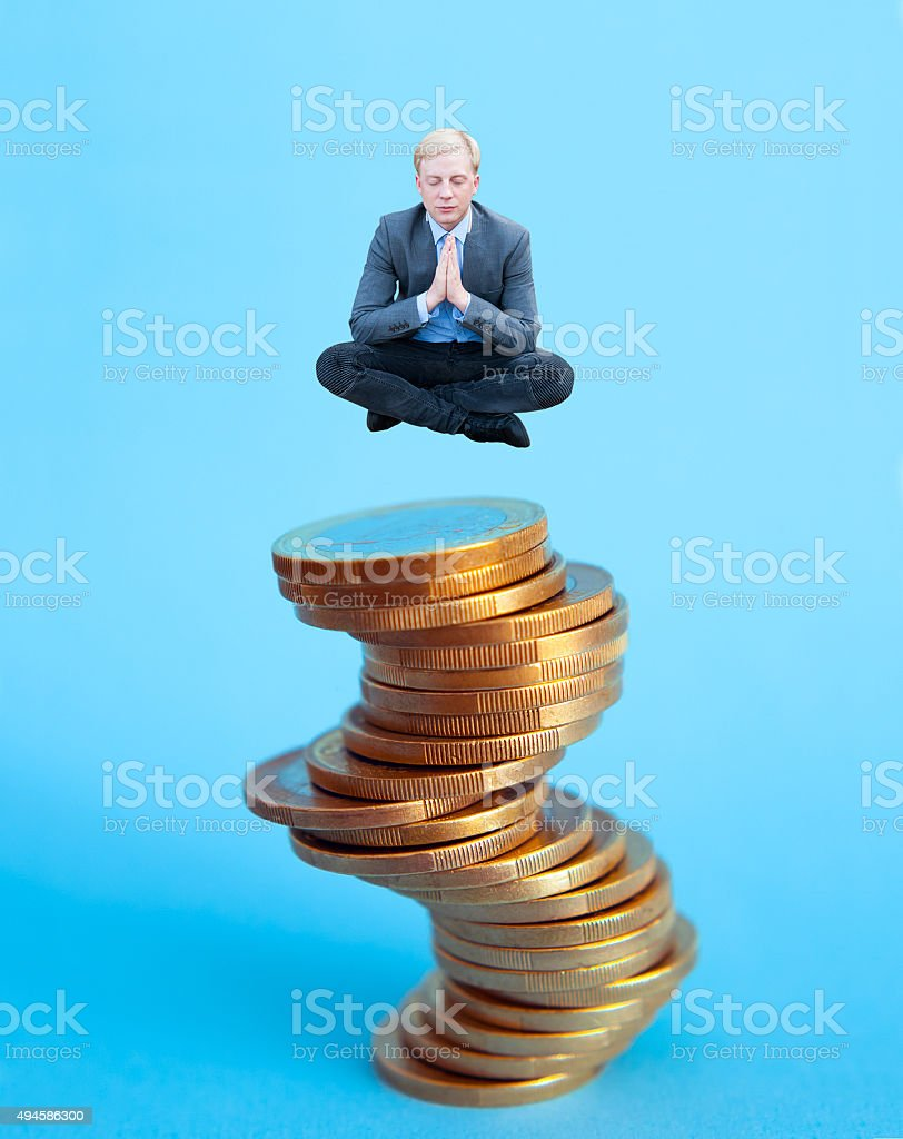 Businessman meditating on the money stock photo