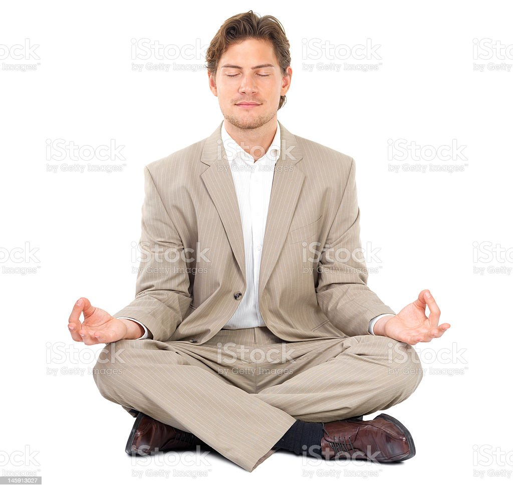 Businessman meditating with eyes closed royalty-free stock photo