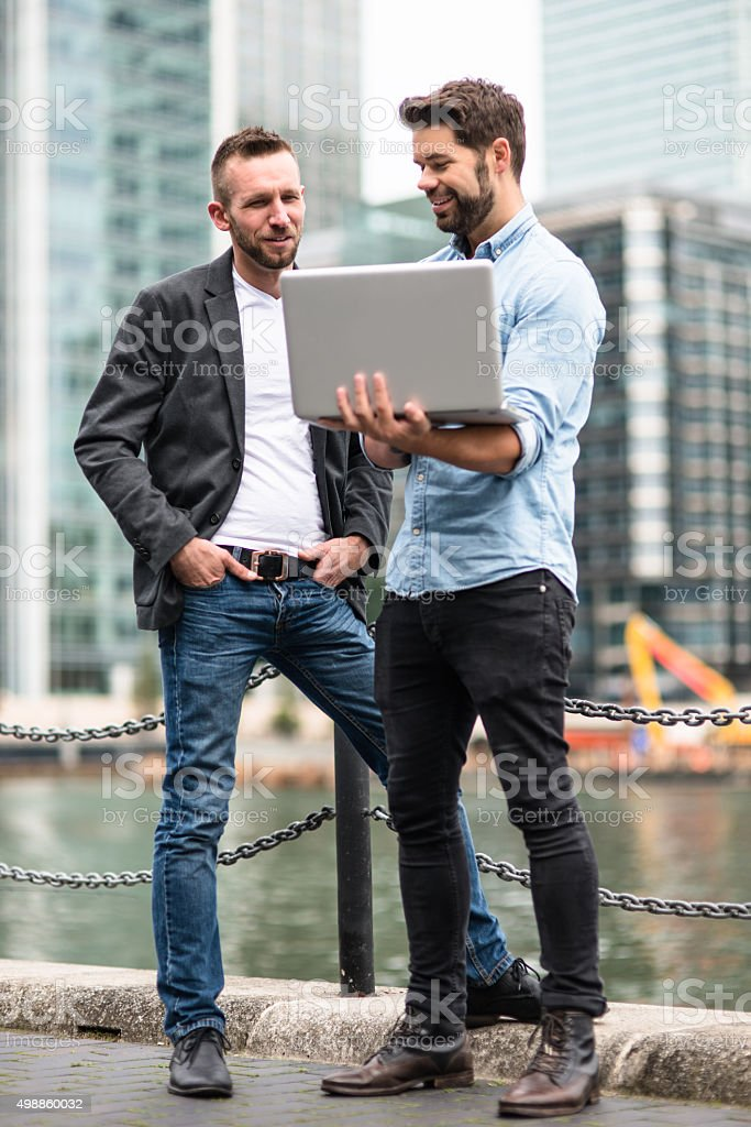 businessman meeting on canary wharf stock photo