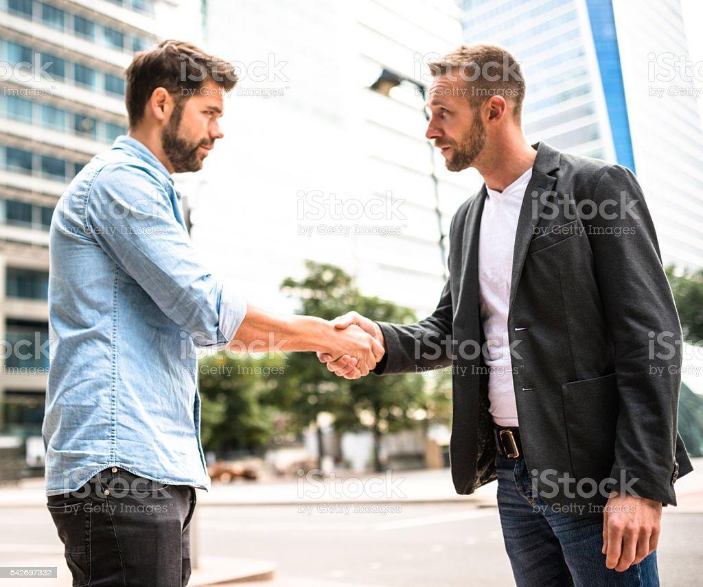 businessman meeting on canary wharf stock photo