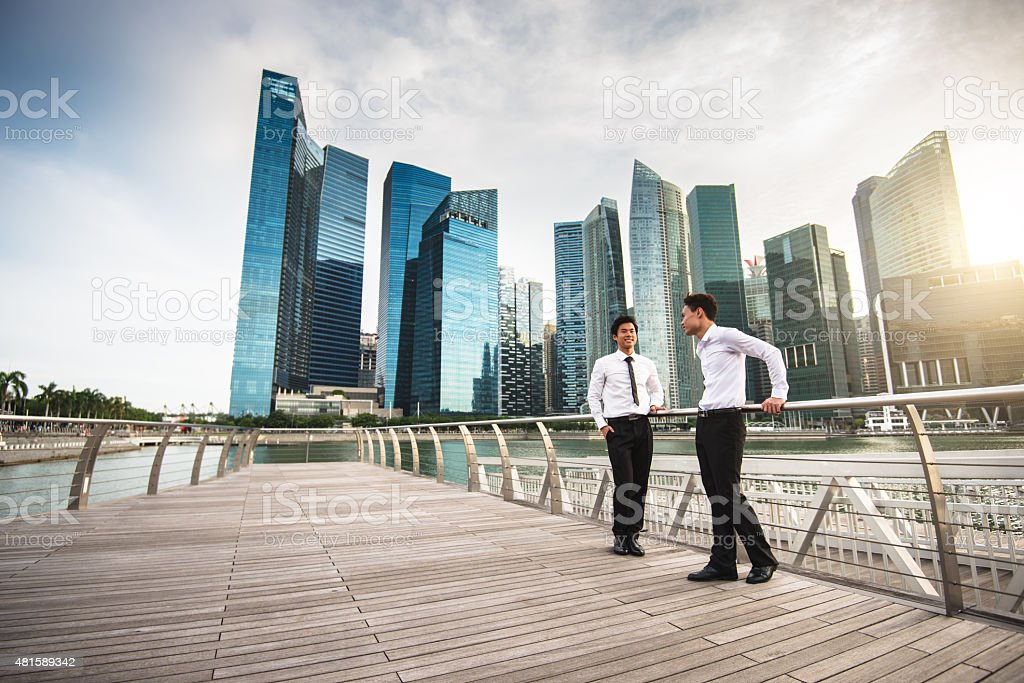 businessman meeting on the city of Singapore stock photo