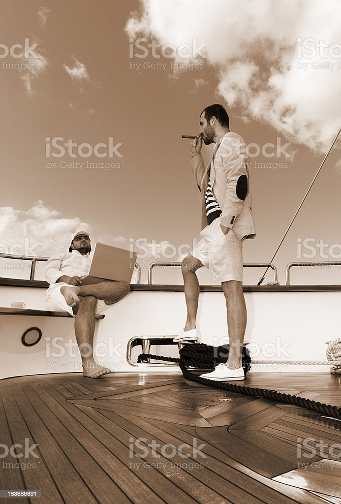 Businessman meeting on the luxury yacht. stock photo