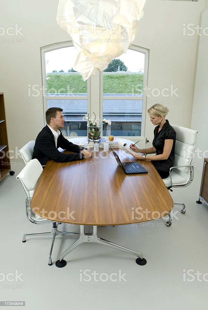 businessman meeting with businesswoman in board room royalty-free stock photo