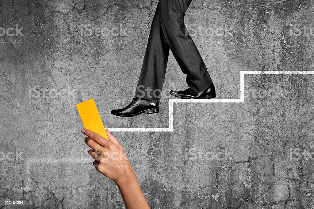 Businessman moving down on stairs stock photo