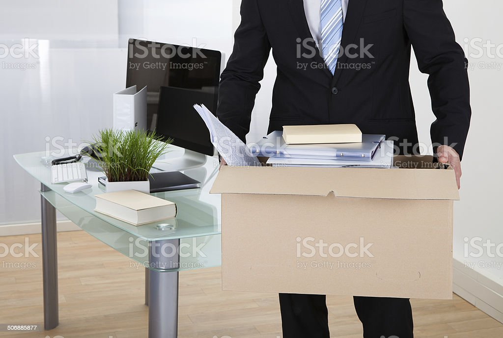Businessman moving offices stock photo
