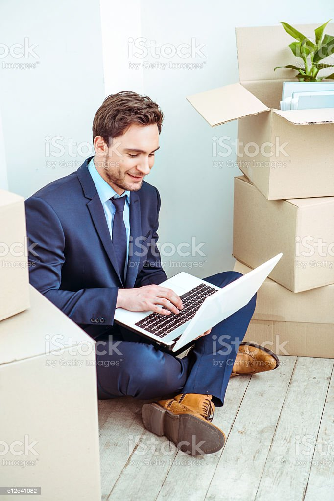 Businessman moving to new home stock photo