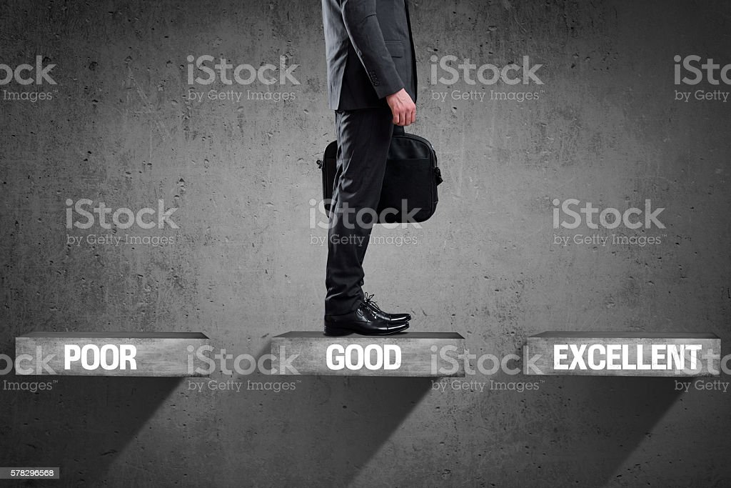 Businessman moving up to the stairs stock photo