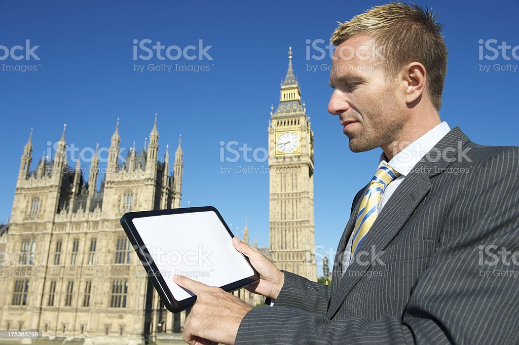 Businessman MP Using Blank Tablet London Houses of Parliament royalty-free stock photo