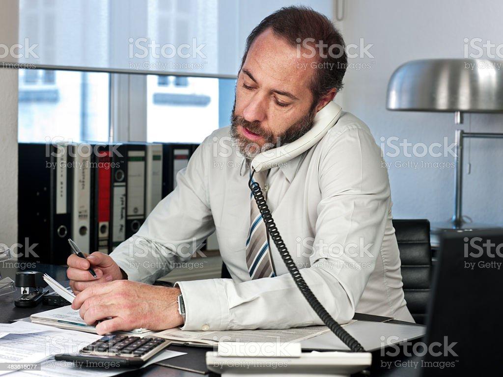 Businessman multitask royalty-free stock photo