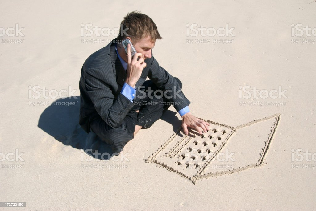 Businessman Multi-Tasking on the Beach Typing and Talking royalty-free stock photo