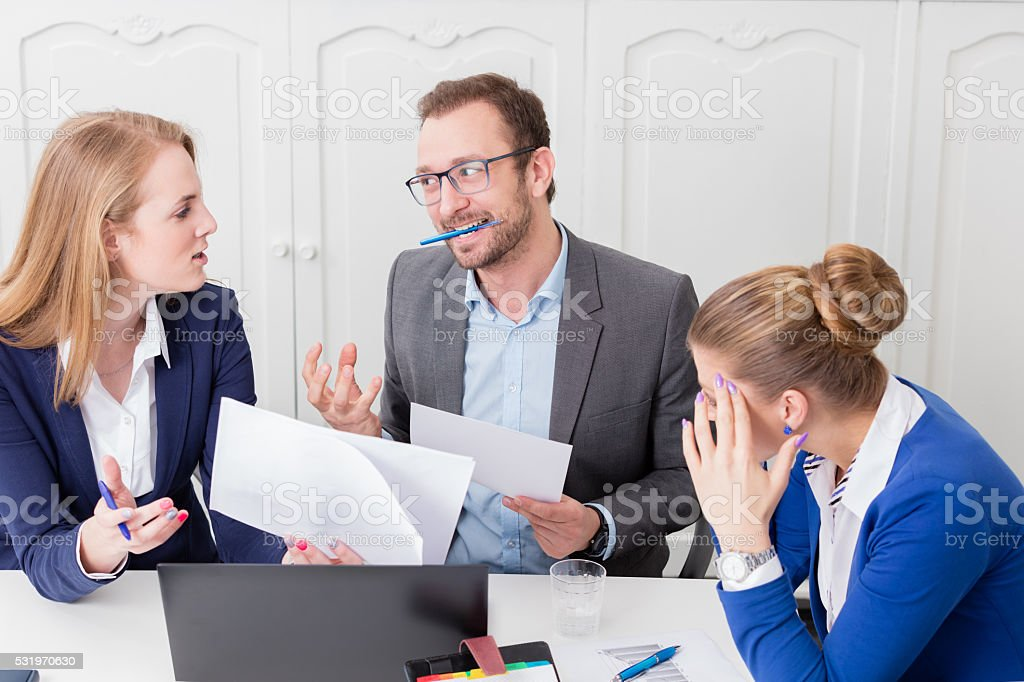 Businessman not satisfied with the proposal of his colleague stock photo