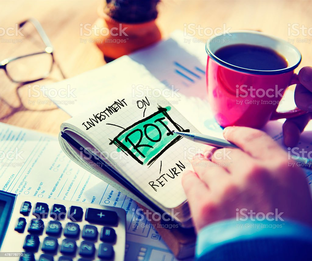 Businessman Notepad Roi Word Concept stock photo
