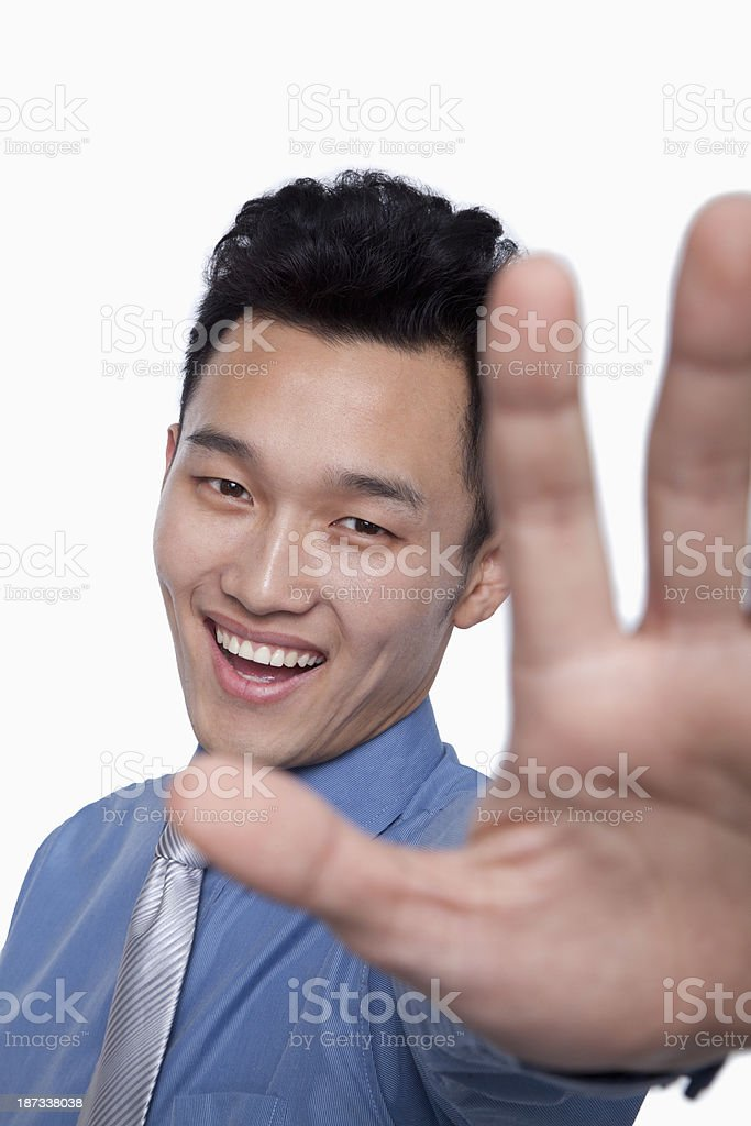 Businessman Obstructing Camera with Hand royalty-free stock photo