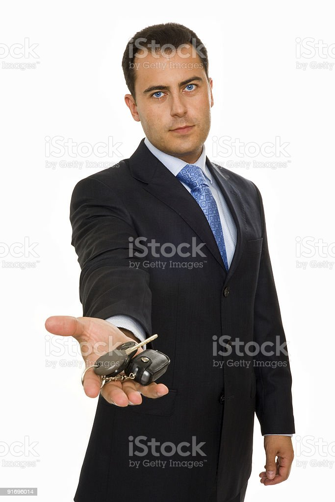 businessman offering a bunch of car keys and alarm system royalty-free stock photo