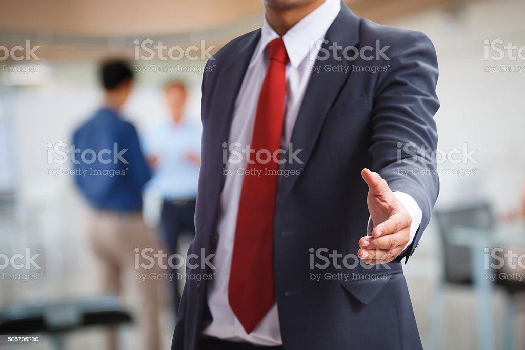 Businessman offering a handshake stock photo