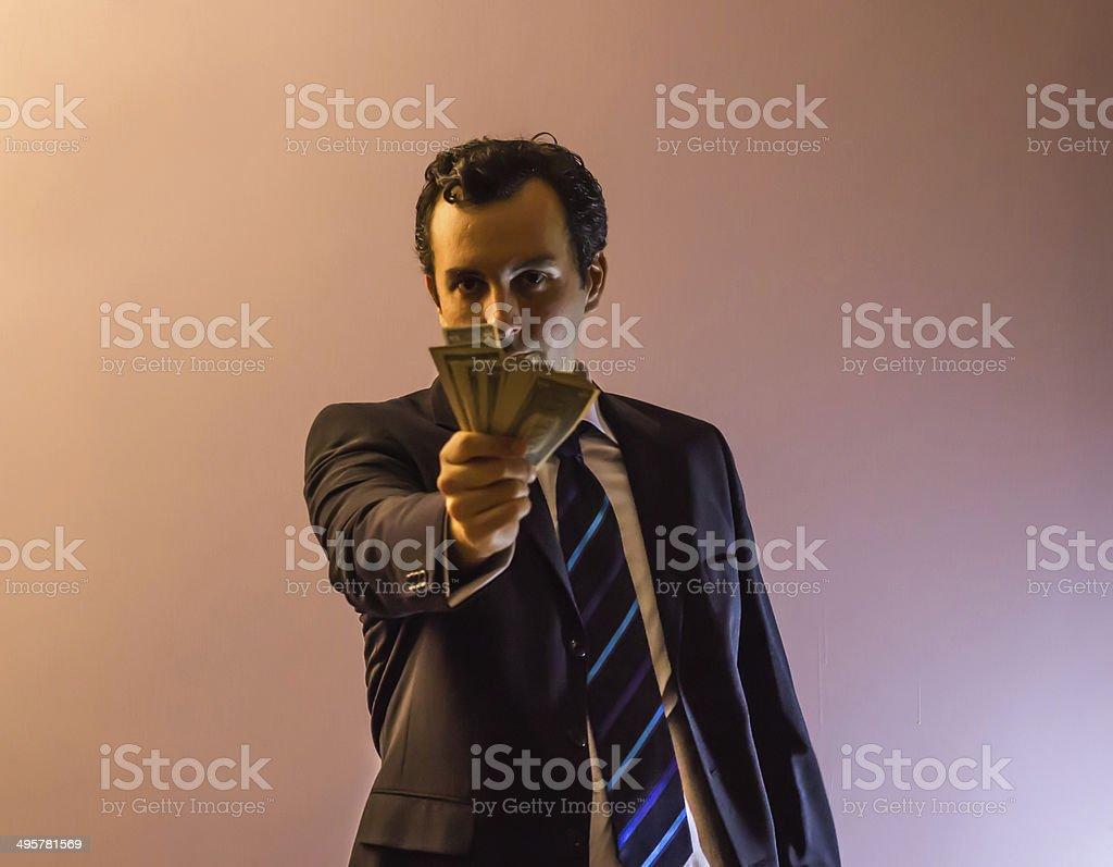 Businessman Offering Dirty Money stock photo