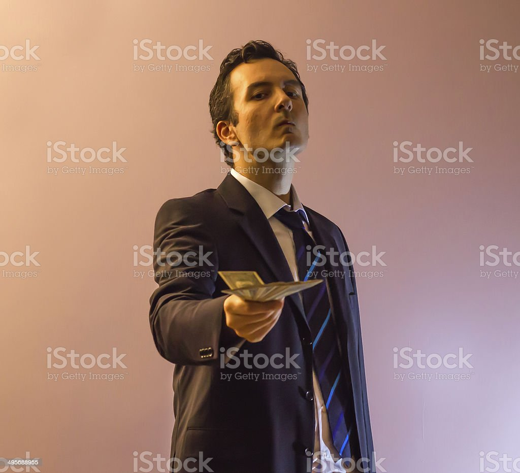 Businessman Offering Dirty Money With Threatening Eyes stock photo