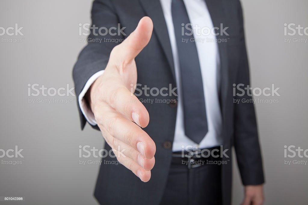 Businessman offering for handshake stock photo