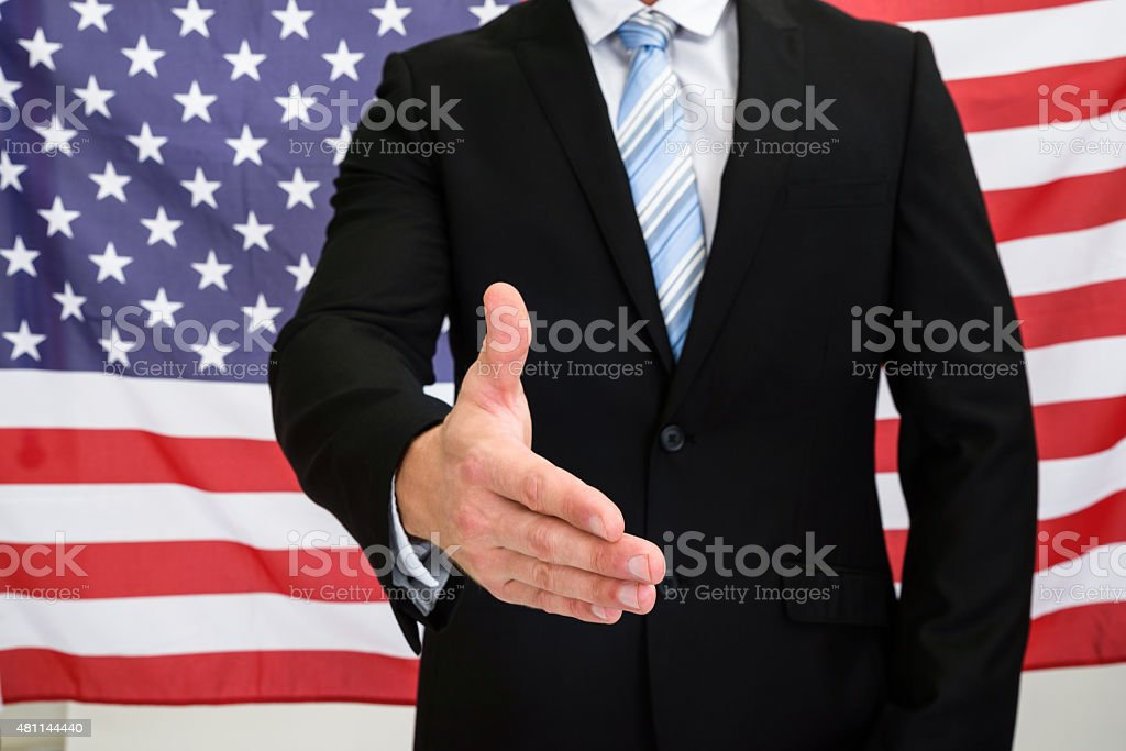 Businessman Offering Handshake stock photo