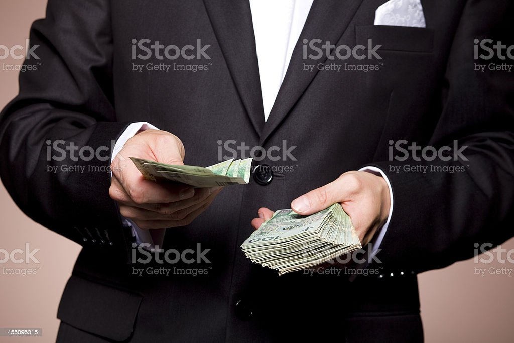 Businessman Offering Money royalty-free stock photo