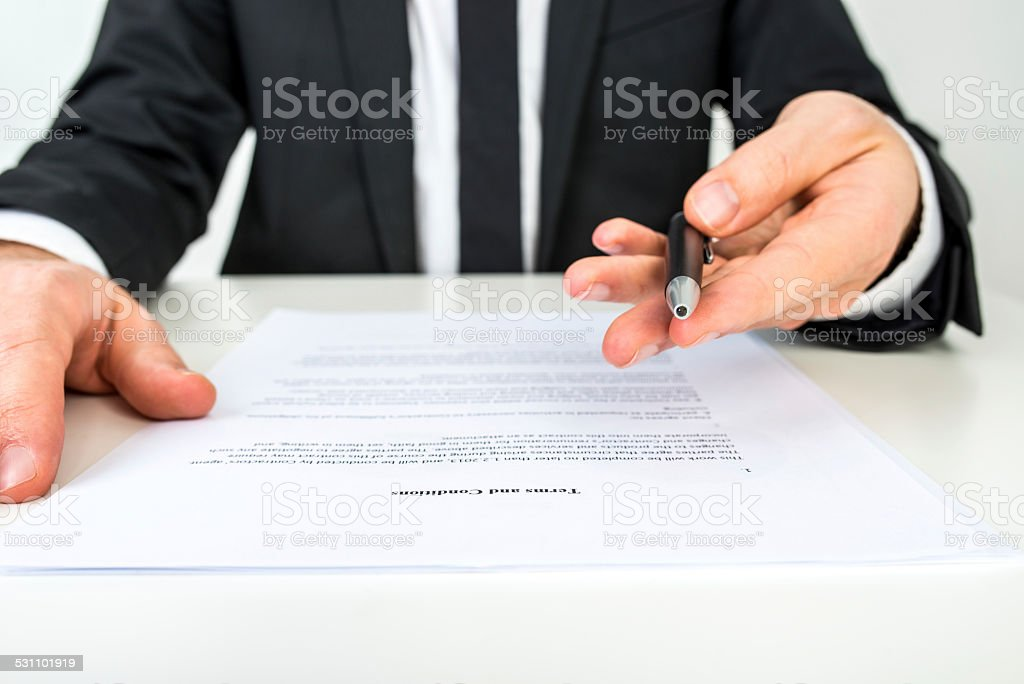 Businessman offering you to sign a document stock photo