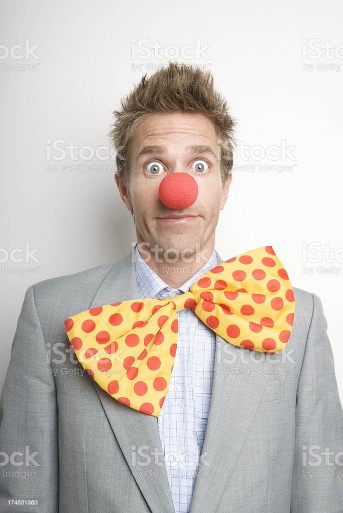 Businessman Office Clown with Red Nose and Bright Bow Tie stock photo