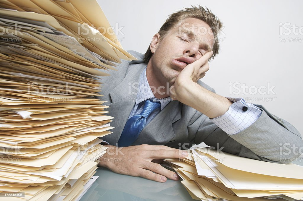 Businessman Office Worker Filing Asleep at the Job on Desk stock photo