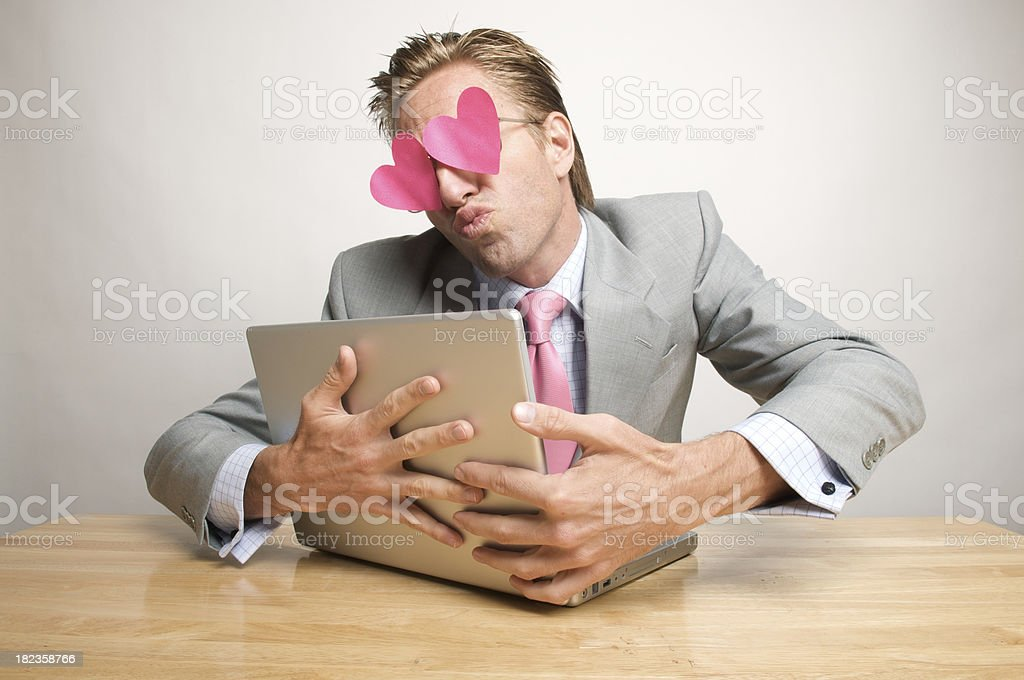 Businessman Office Worker Hugging and Kissing Laptop with Hearts stock photo