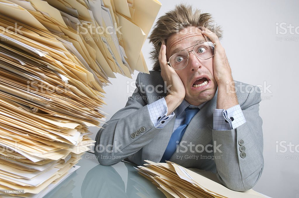 Businessman Office Worker Looks at Pile of Files in Fear royalty-free stock photo
