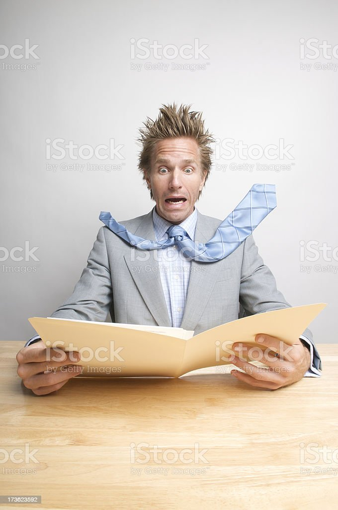 Businessman Office Worker Looks Surprised at File Folder Document royalty-free stock photo