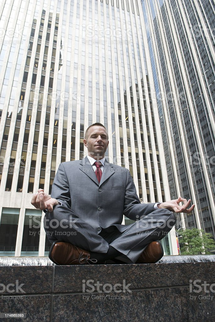 Businessman Office Worker Meditating Yoga in City Plaza royalty-free stock photo