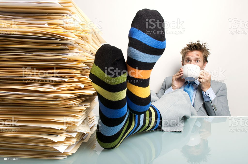 Businessman Office Worker Relaxing Cup of Coffee Feet on Desk royalty-free stock photo