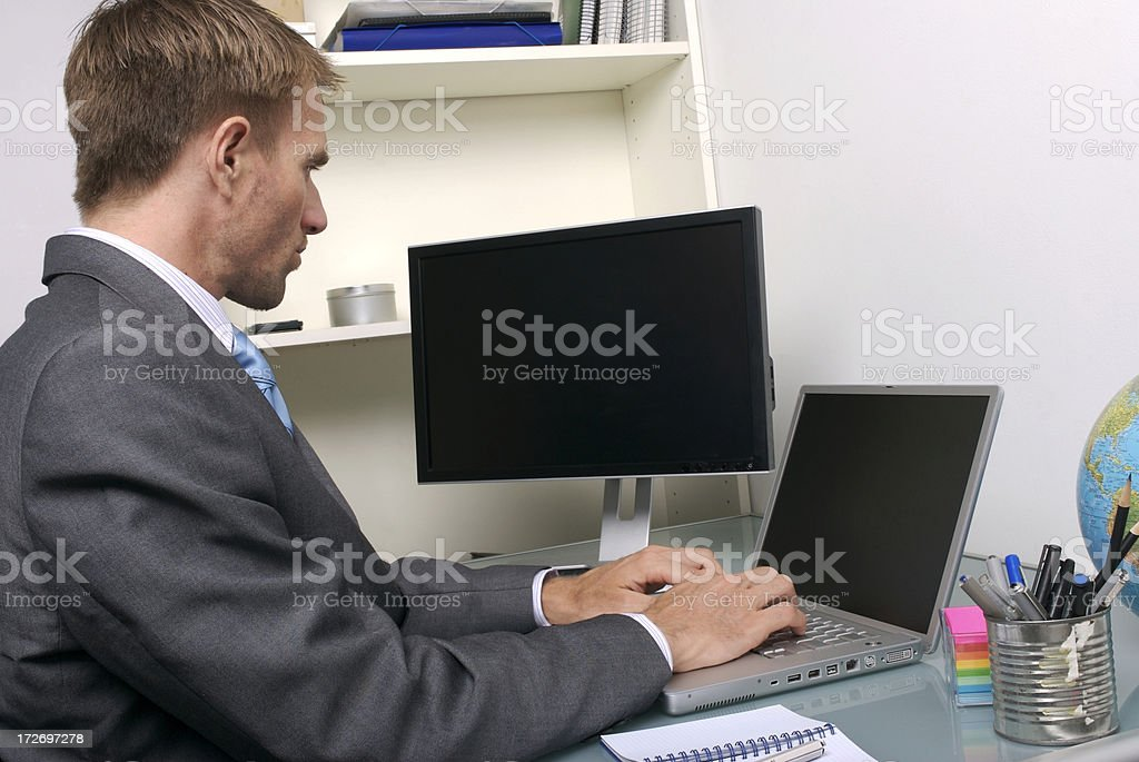 Businessman Office Worker Sits Working at Desk Two Computer Screens royalty-free stock photo