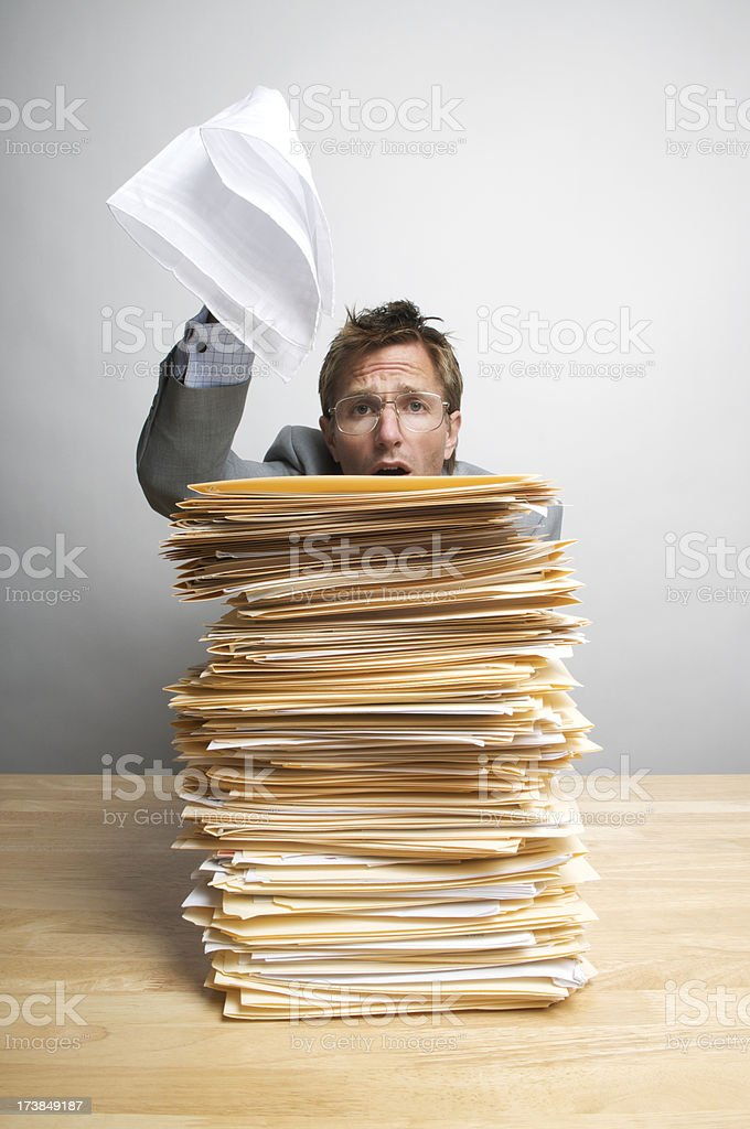 Businessman Office Worker Surrenders with White Flag at Desk royalty-free stock photo