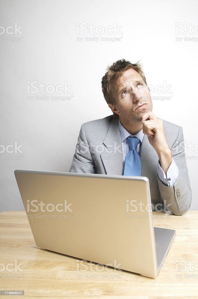 Businessman Office Worker Thinks in front of his Computer royalty-free stock photo