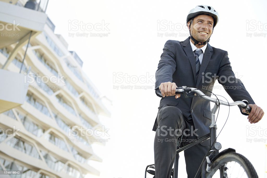 Businessman on a bike royalty-free stock photo