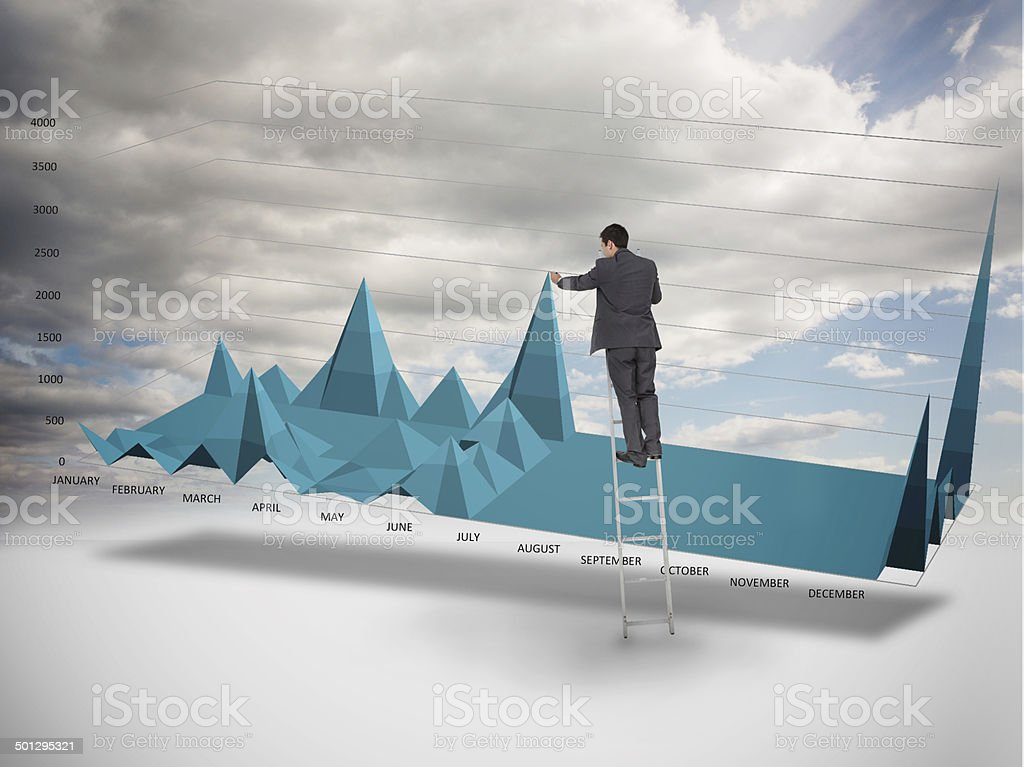 Businessman on a ladder catching the tip of chart stock photo