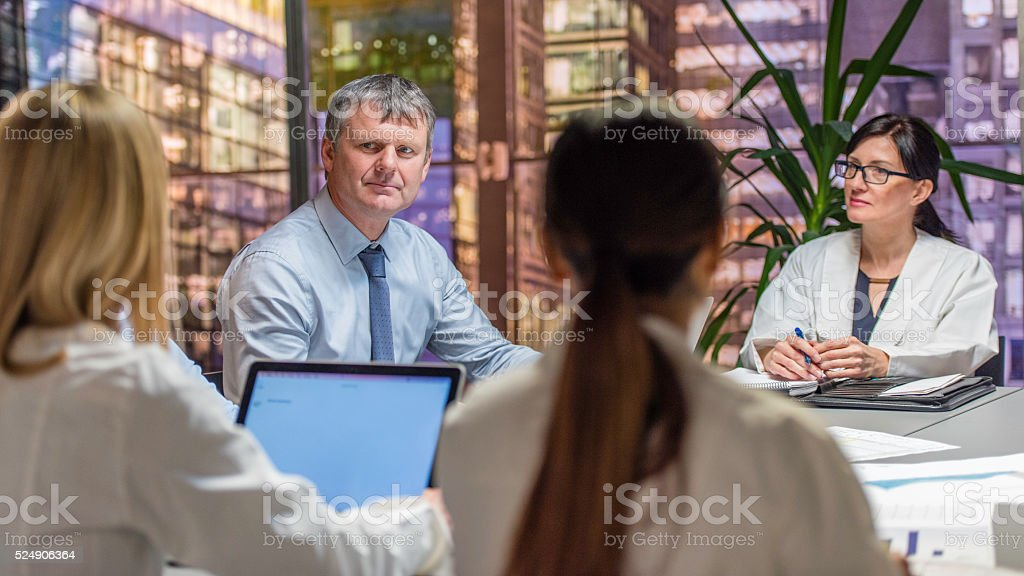 Businessman on a meeting with doctors stock photo