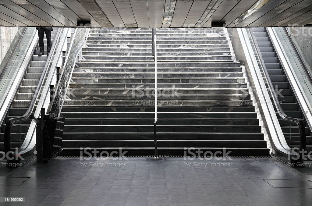 Businessman on a subway station stairs. stock photo