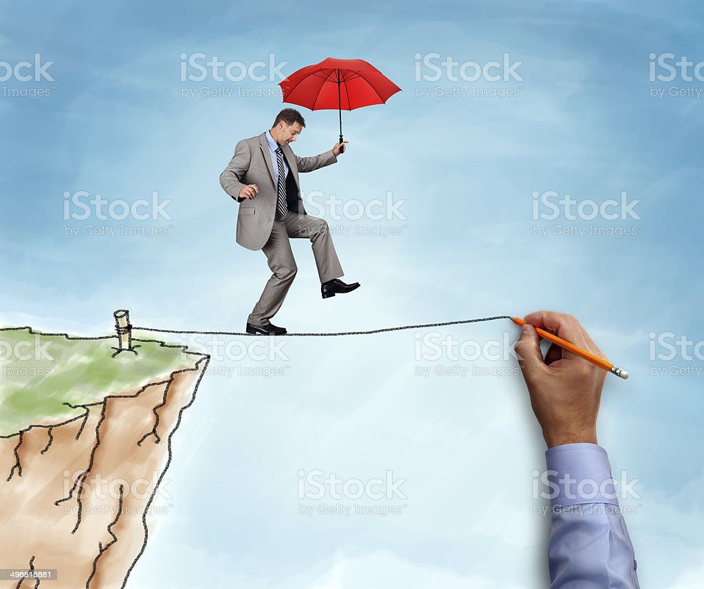 Businessman on a tightrope stock photo