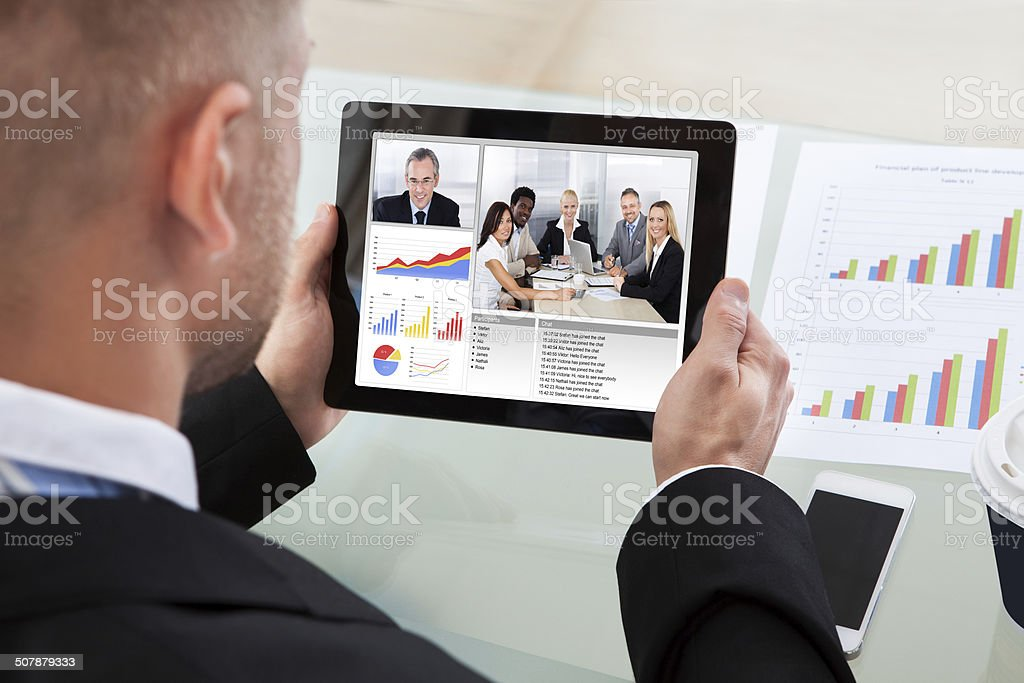 Businessman on a video or conference call on his tablet stock photo