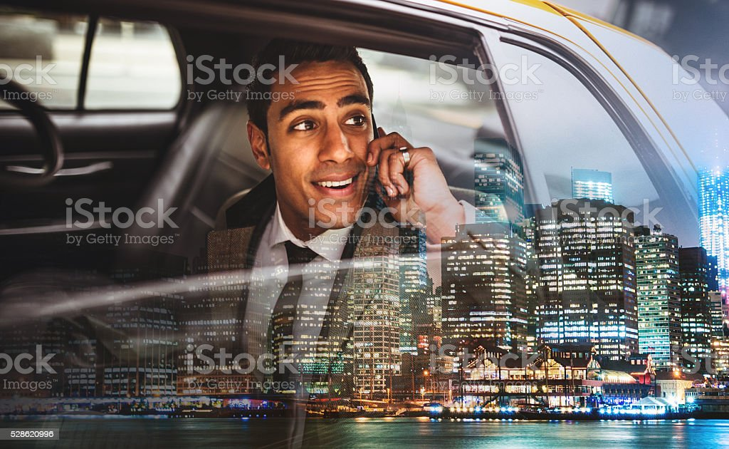 Businessman on a yellow cab in New York City stock photo