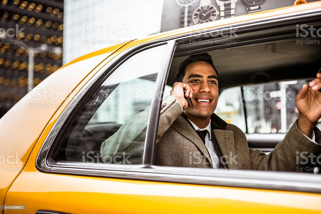 Businessman on a yellow cab stock photo