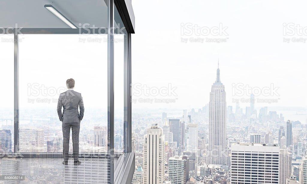 Businessman on balcony back stock photo