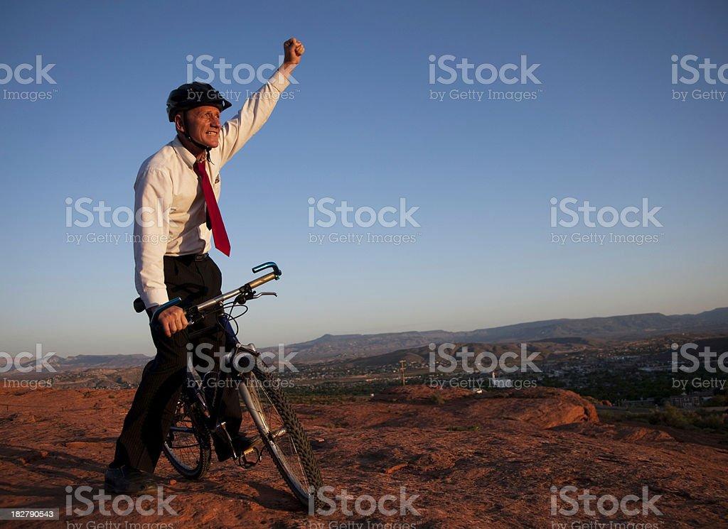 Businessman on Bicycle Celebrating royalty-free stock photo