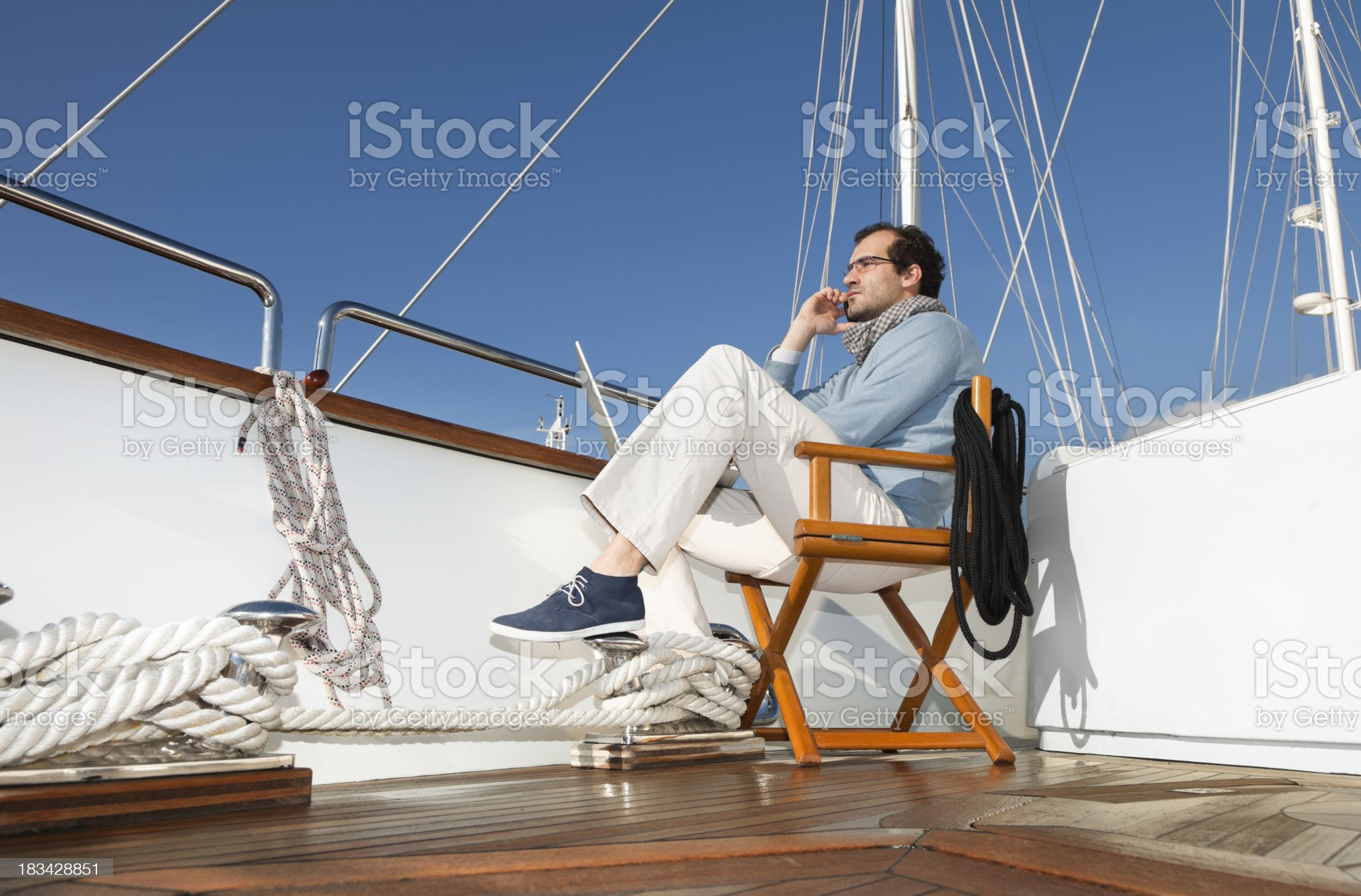 Businessman on board of the yacht working with laptop royalty-free stock photo