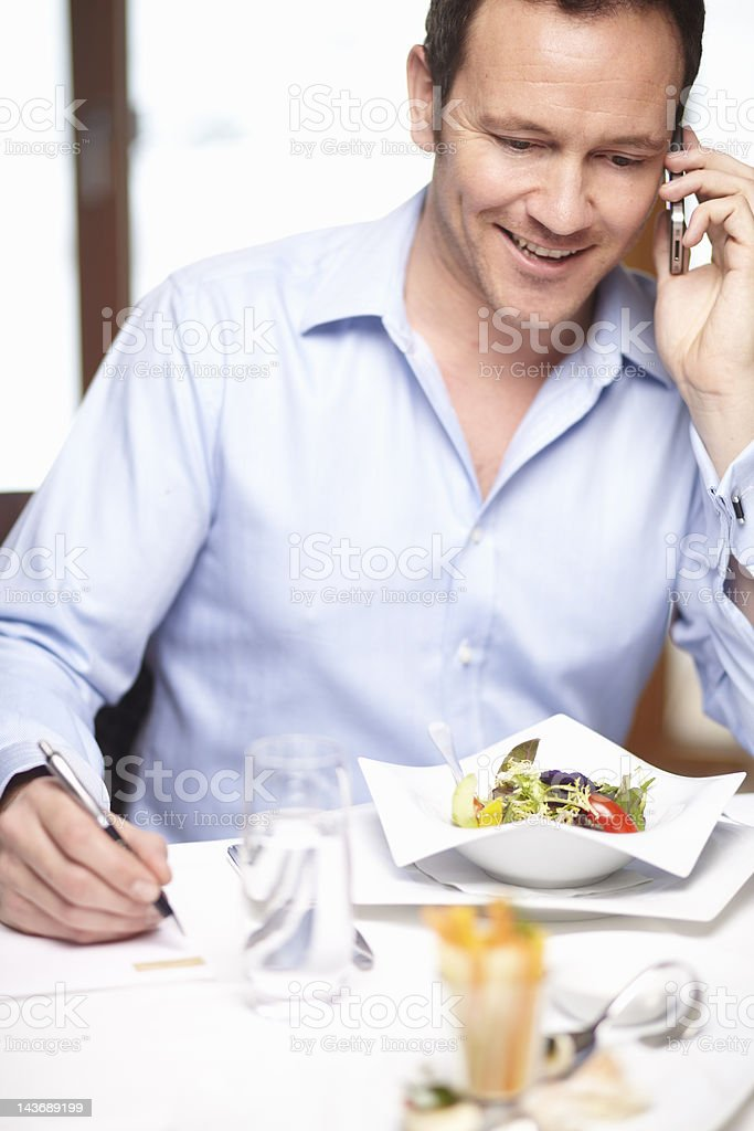 Businessman on cell phone in cafe royalty-free stock photo