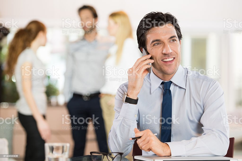 Businessman on cell phone stock photo